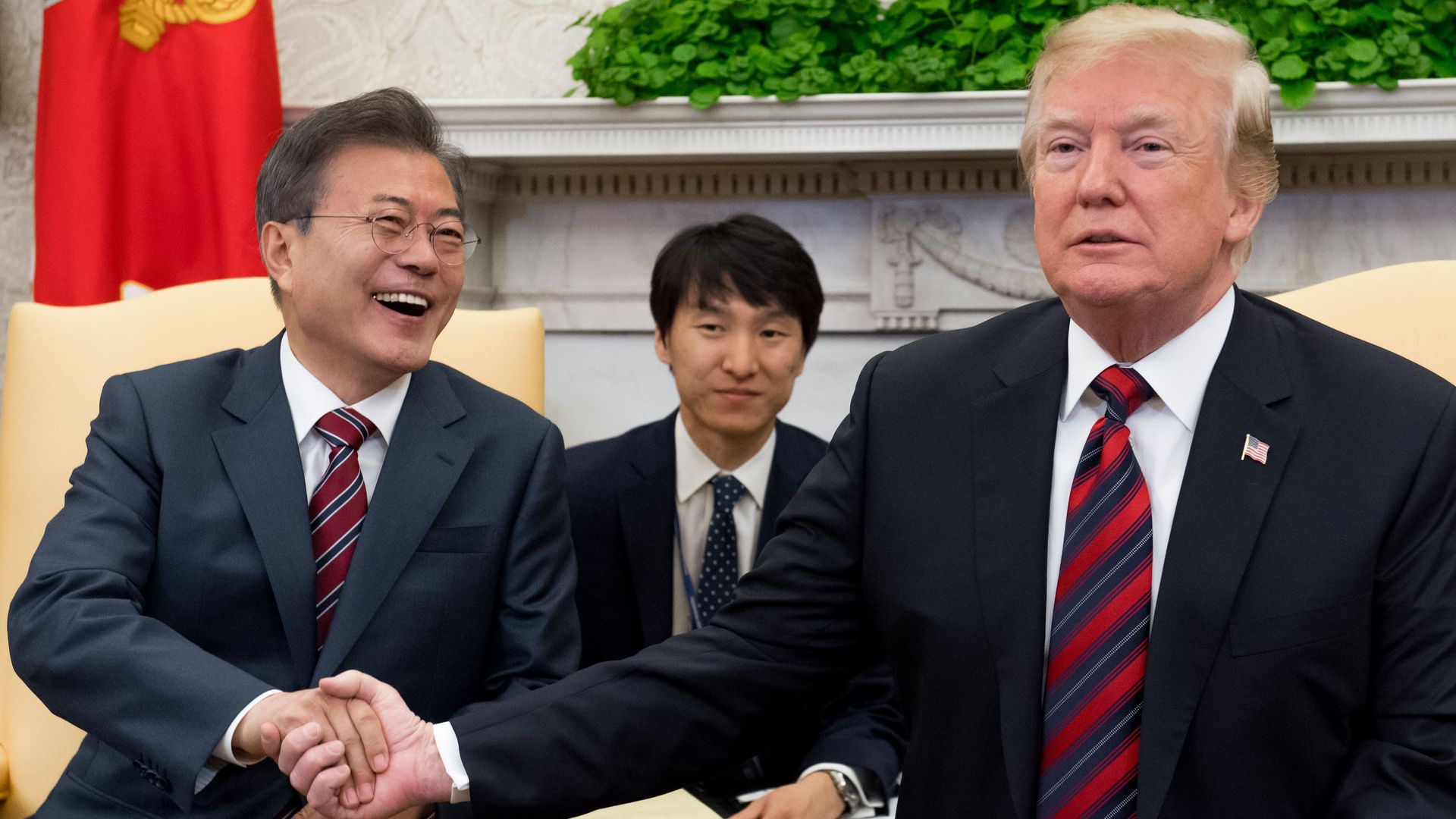 Presidents Moon Jae-in and Donald Trump shake hands at White House