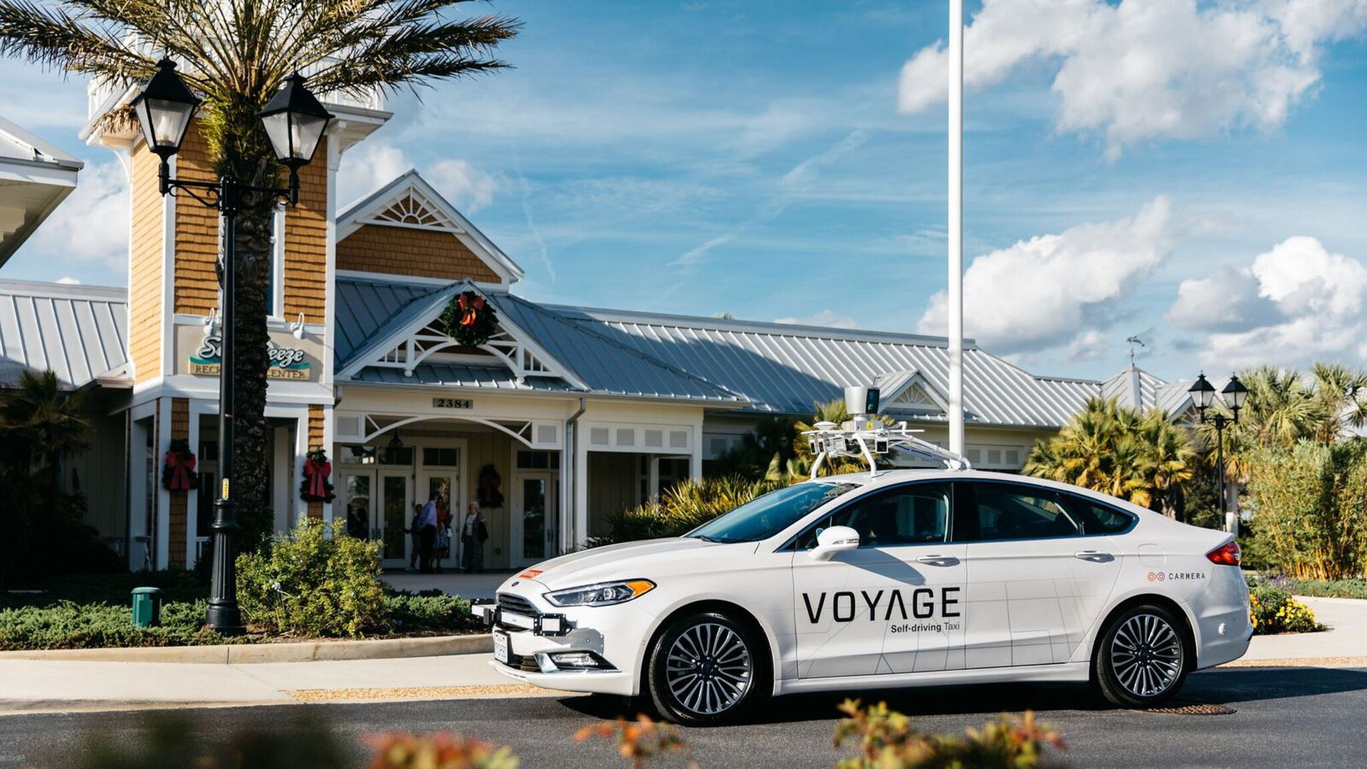 Voyage low-speed AV parked in a Florida retirement community