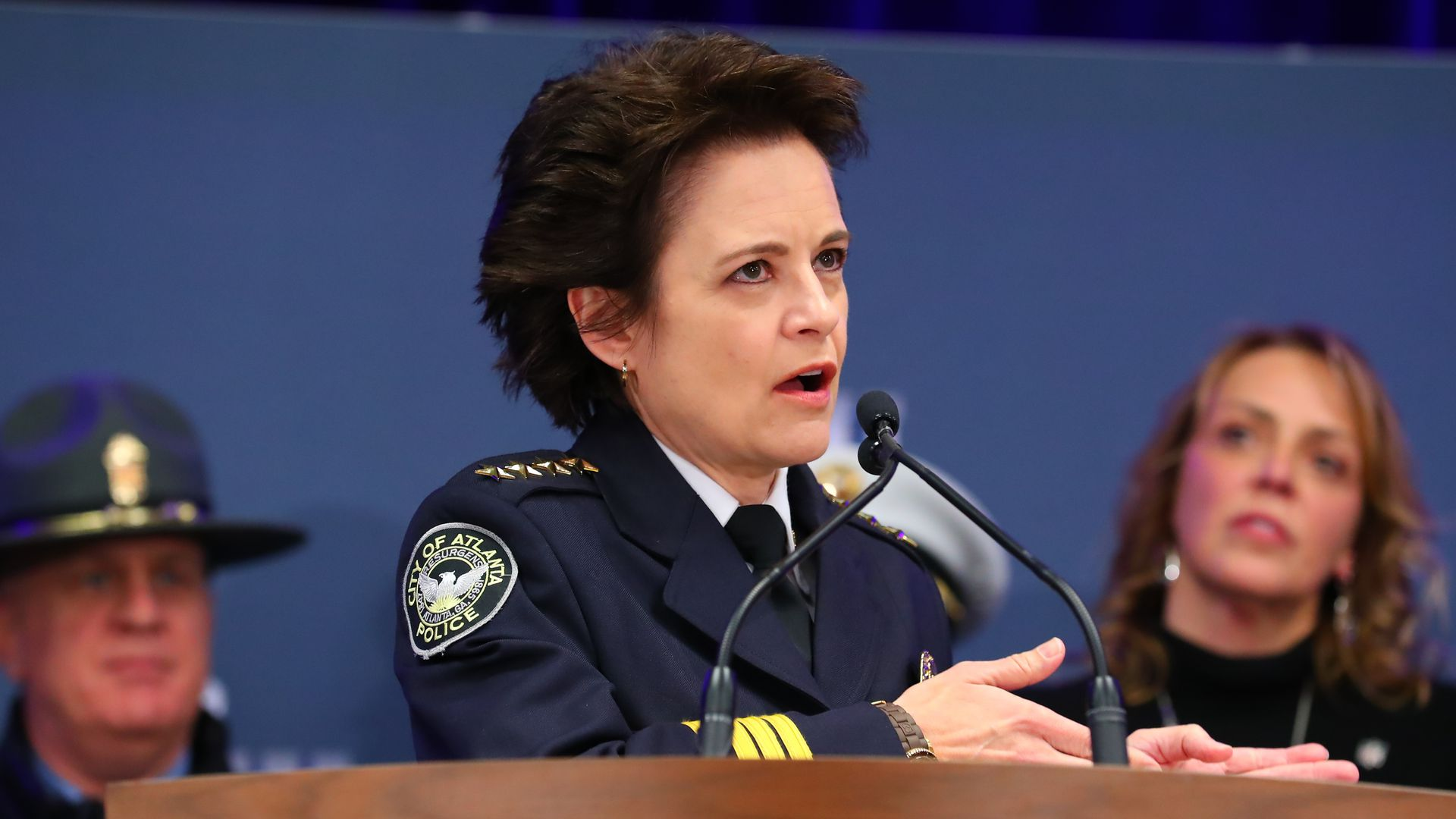 In this image, the Atlanta police chief speaks into a microphone from behind a podium.