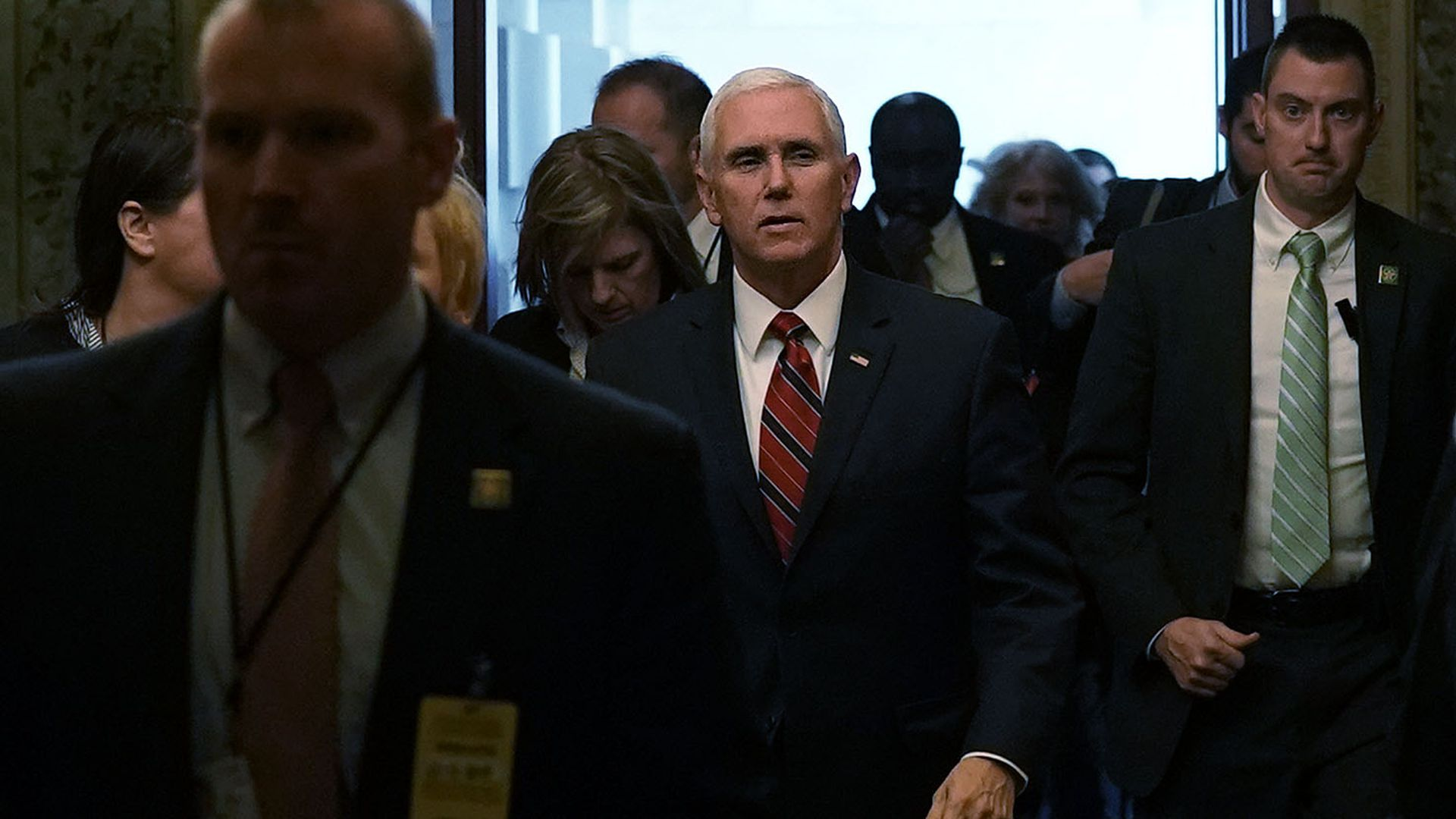 Vice President Mike Pence walks through a crowd of people at the Capitol
