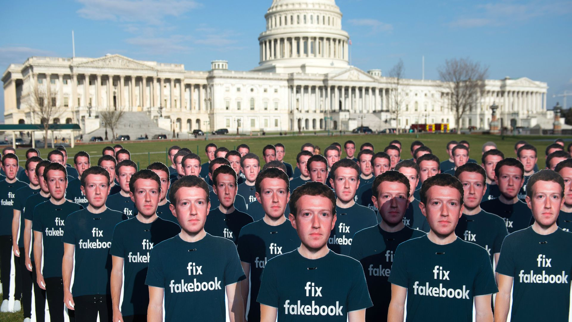 ne hundred cardboard cutouts of Facebook founder and CEO Mark Zuckerberg stand outside the US Capitol