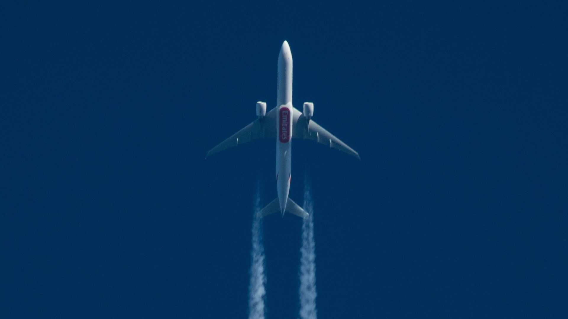 A Boeing 777 of Emirates Airlines pictured flying at high altitude.