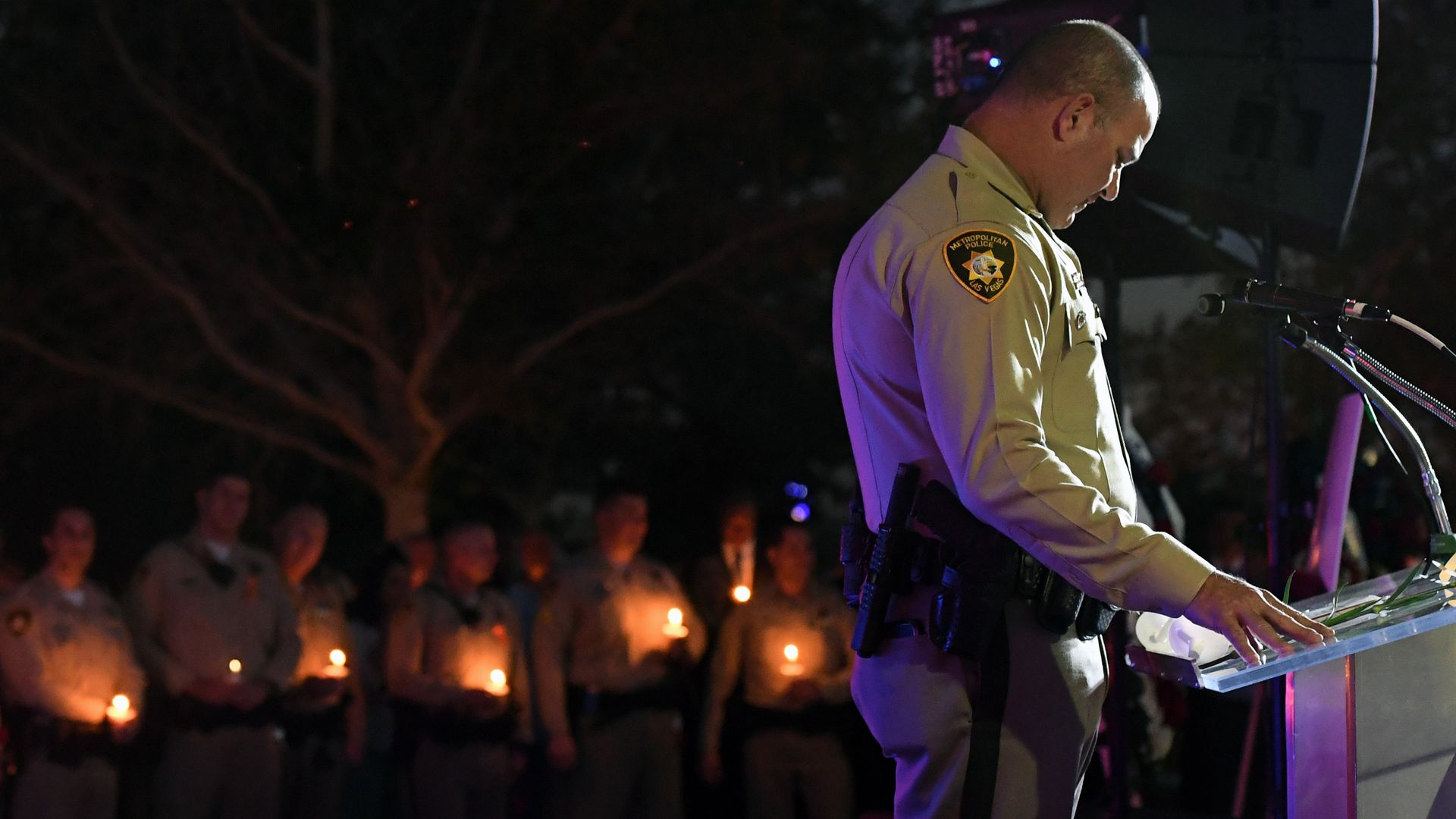 A Las Vegas police officer speaks at a vigil for the victims of the Las Vegas shooting.
