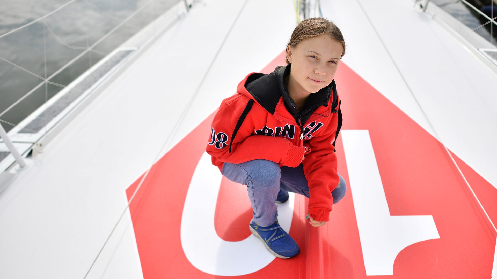 Swedish climate activist Greta Thunberg poses for a photograph during an inteview with AFP onboard the Malizia II sailing yacht at the Mayflower Marina in Plymouth, southwest England, on August 13