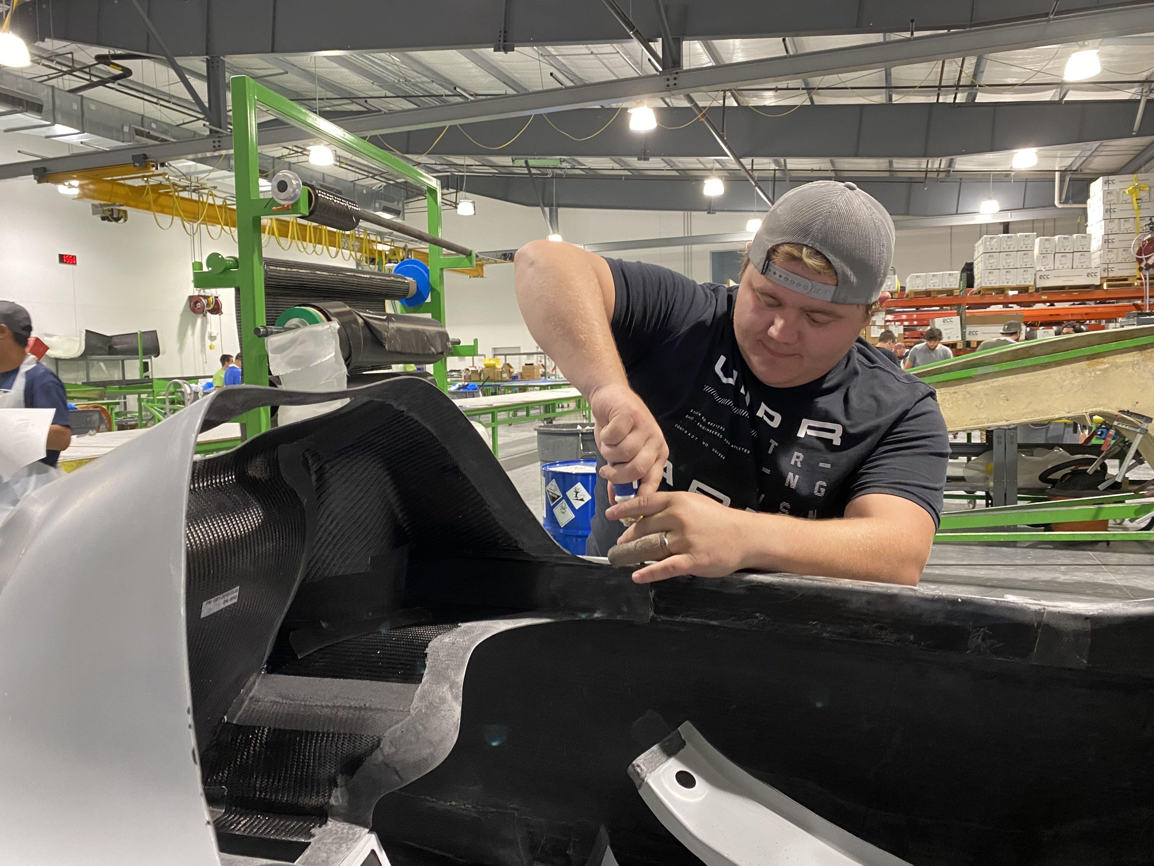 A worker assembles parts of a GameBird 1 fuselage.