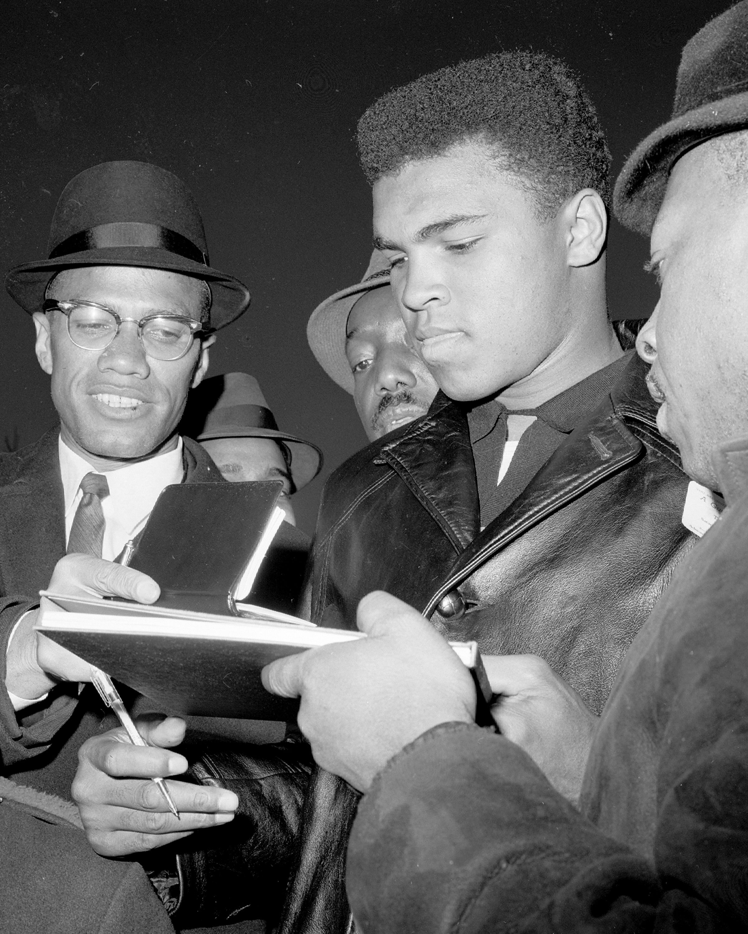Cassius Clay (Muhammad Ali) signing autographs