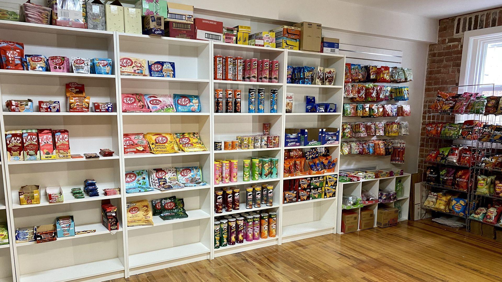 Shelves full of snacks at It's A Bodega