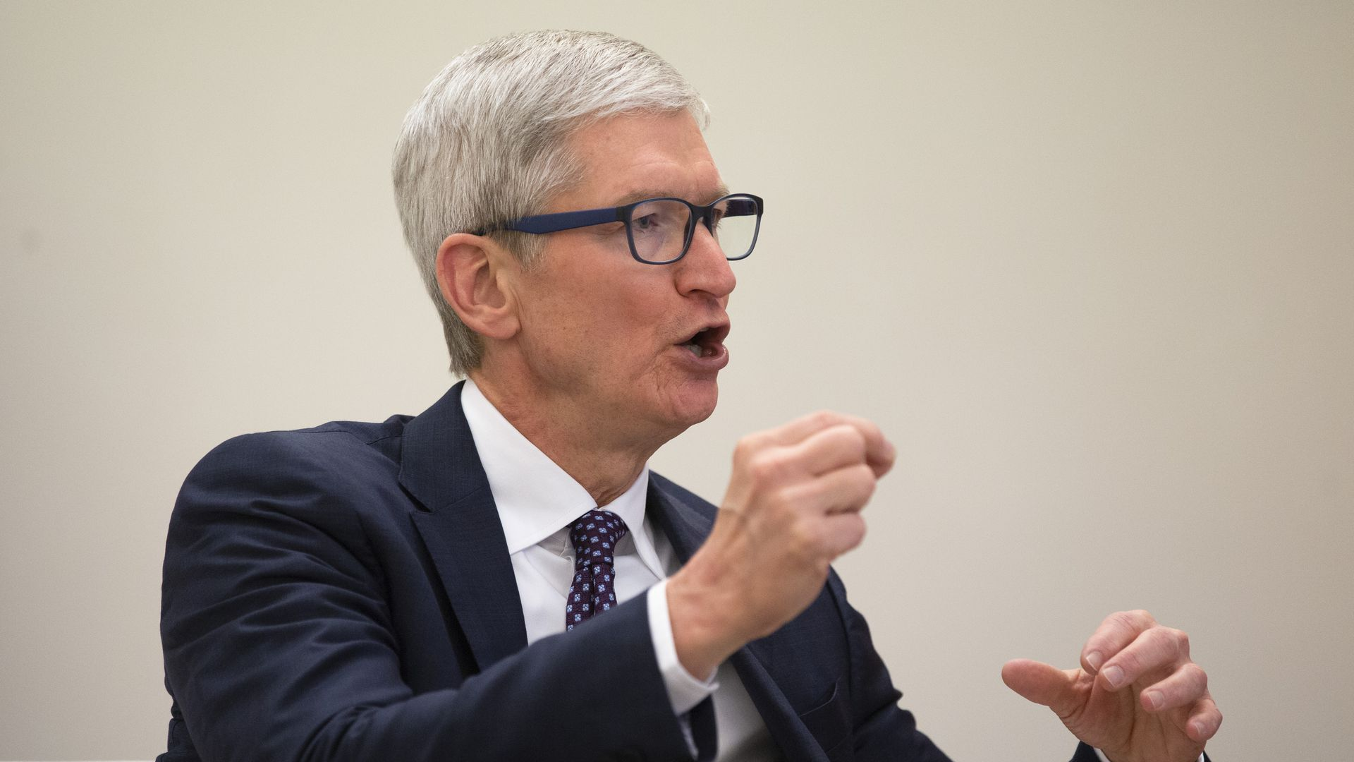 Tim Cook gesticulates during a speech.