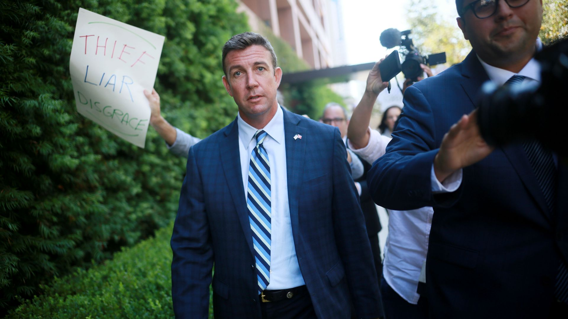 Congressman Duncan Hunter walks out of the San Diego Federal Courthouse after an arraignment hearing Thursday. Photo: Sandy Huffaker/Getty Images