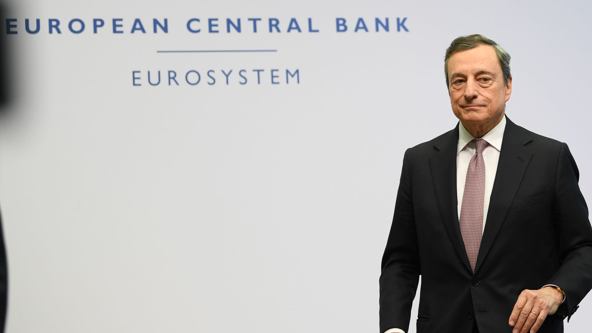Mario Draghi leaves a panel following the press conference at the ECB's headquarters