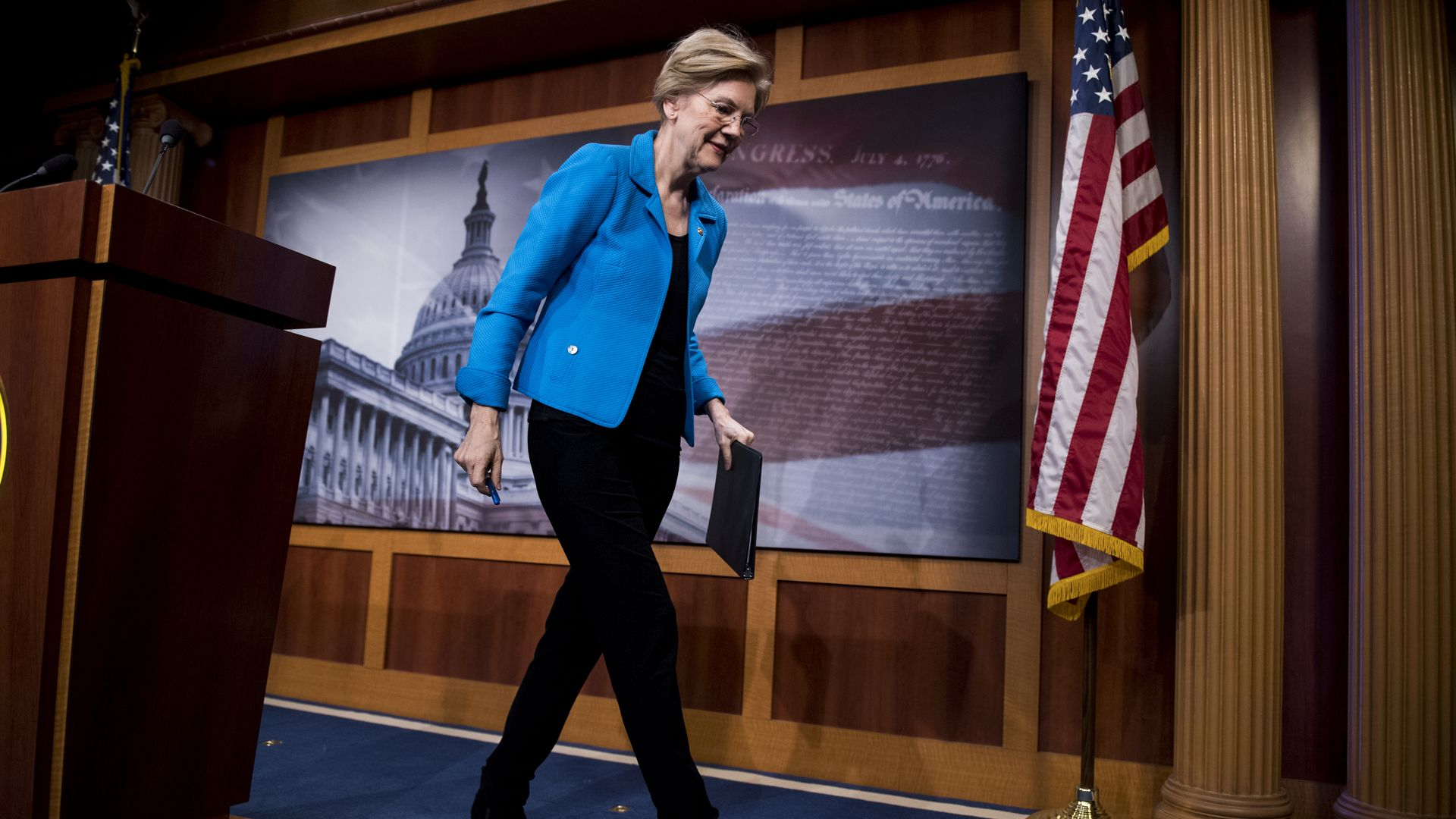 Sen. Elizabeth Warren, D-Mass., walks away form the podium after holding a news conference