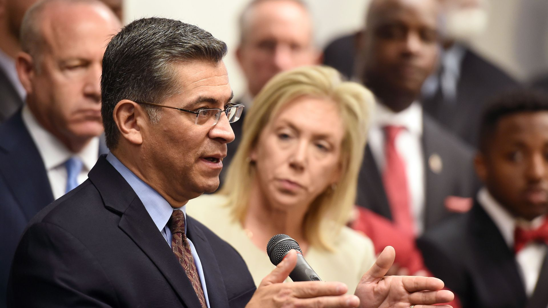 Xavier Becerra speaking at a press conference.