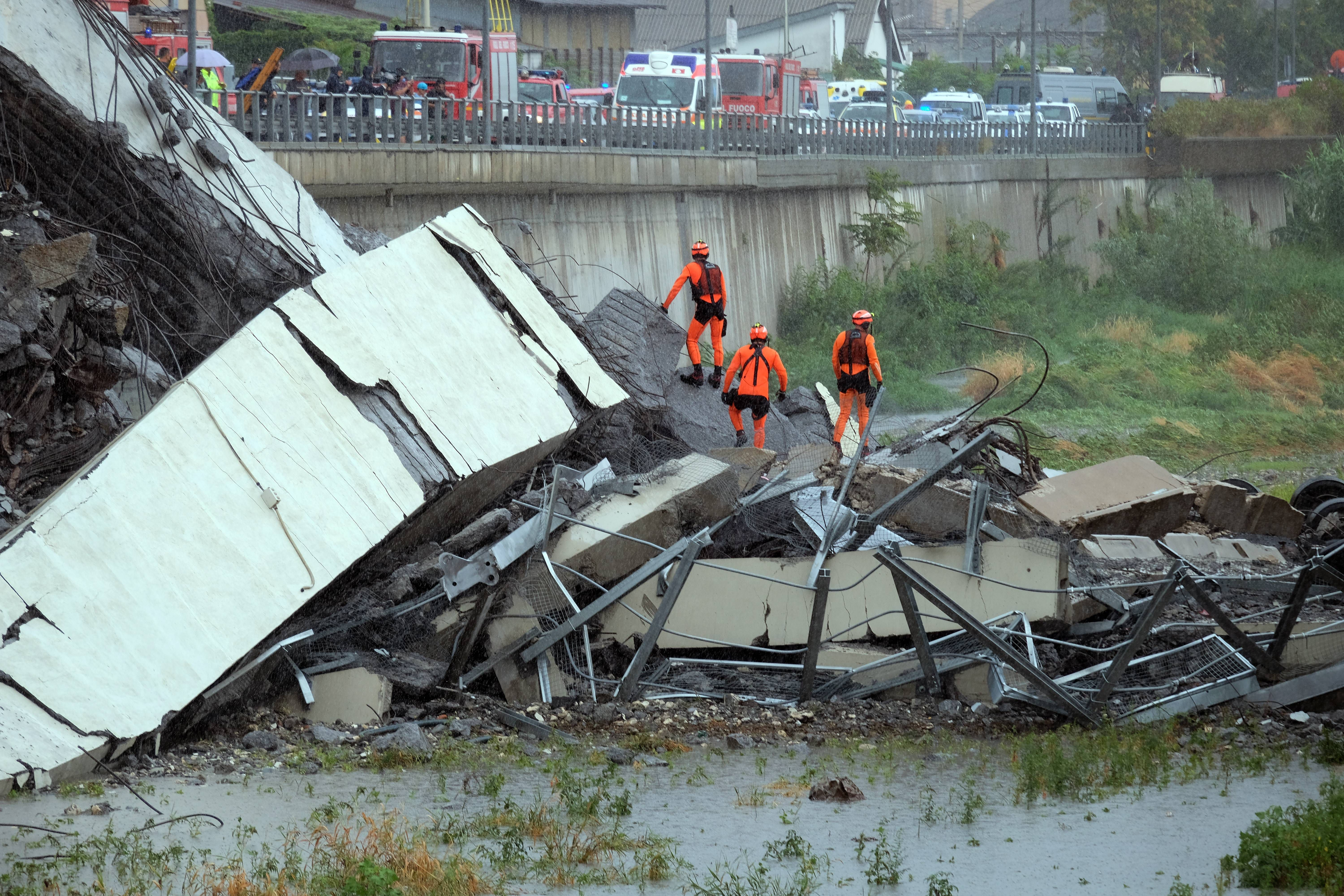 Rescuers at work at the bridge collapse in Italy.
