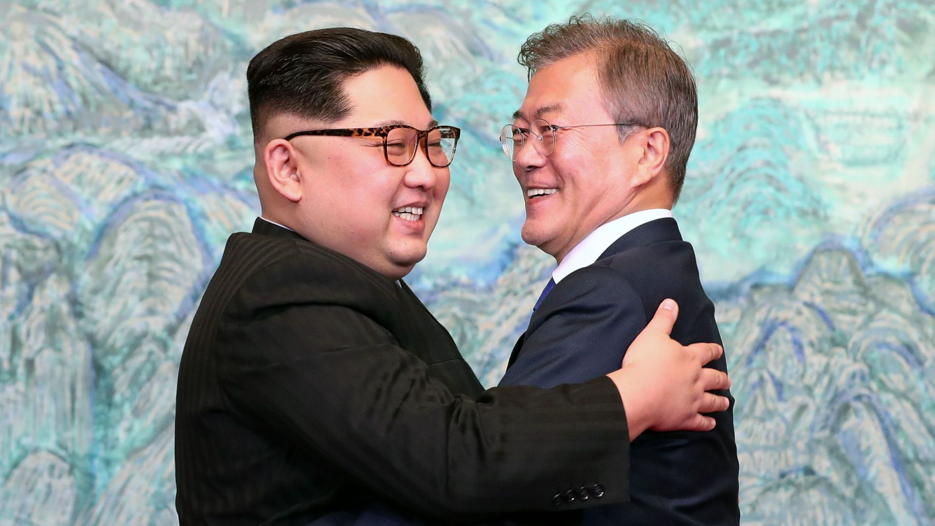Kim Jong-un and Moon Jae-in embrace