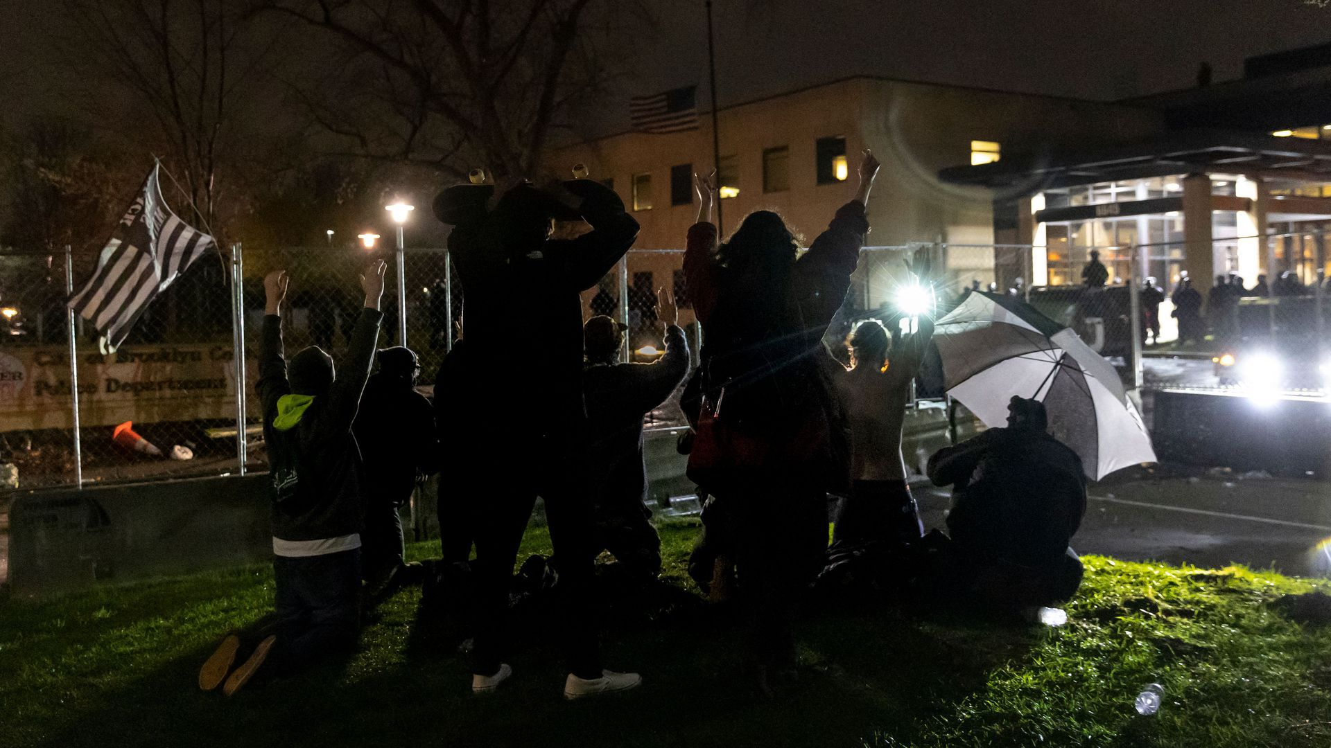 """Demonstrators shout """"Don't shoot"""" at the police after curfew on April 12 as they protest the death of Daunte Wright"""