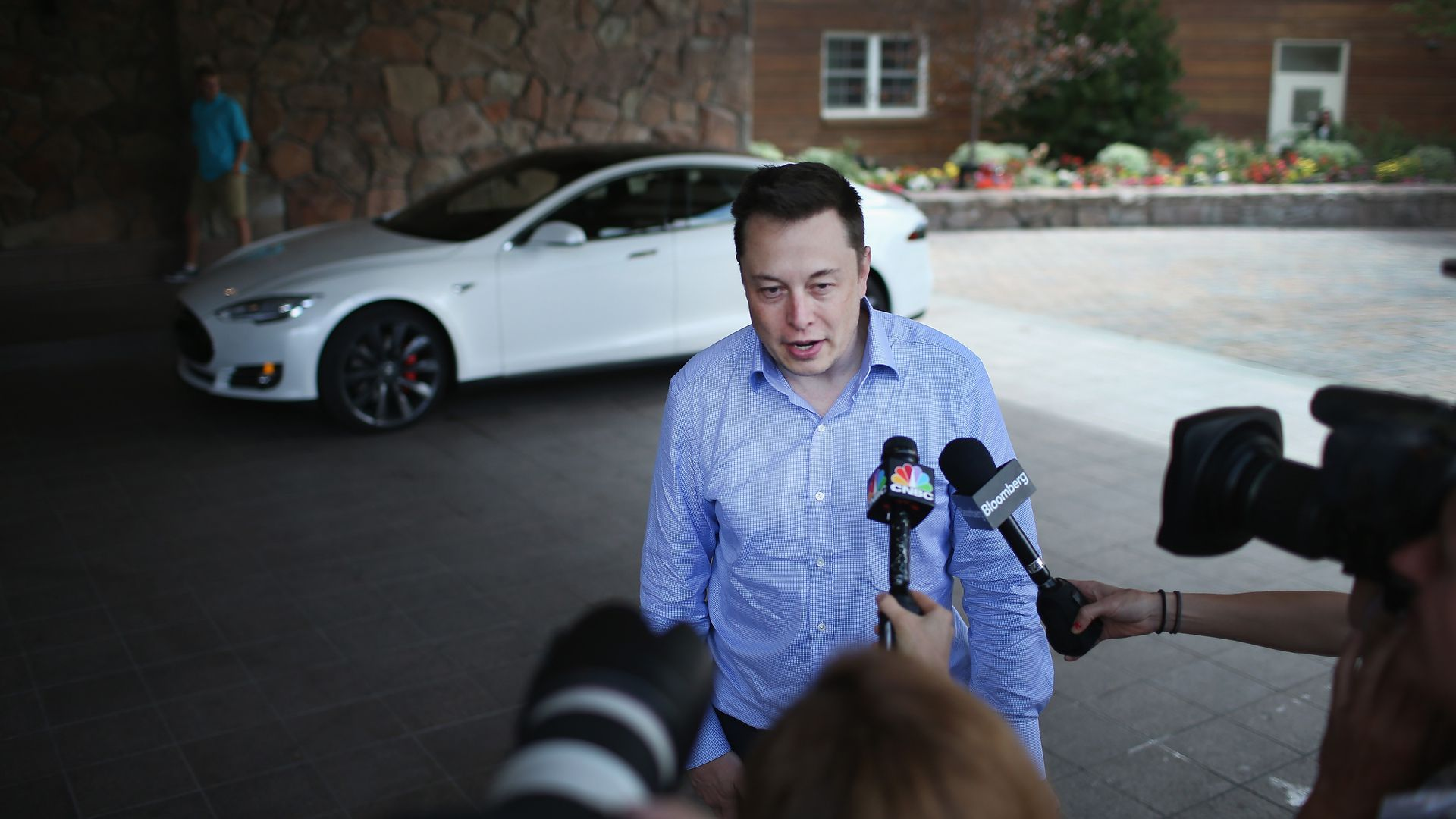Elon Musk speaking to reporters.