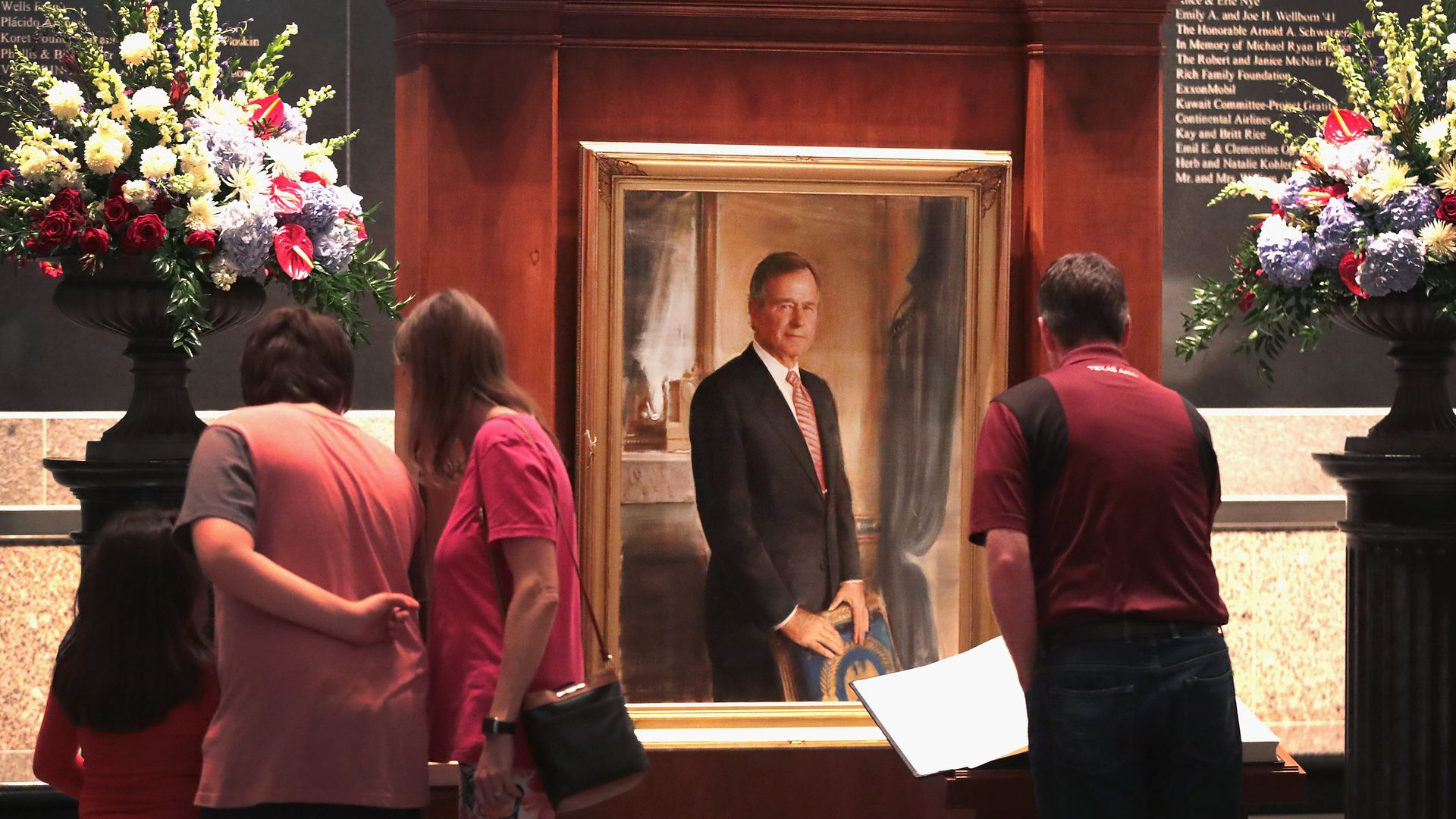 Visitors sign a guest book at the George H.W. Bush Presidential Library Center in College Station, Texas.