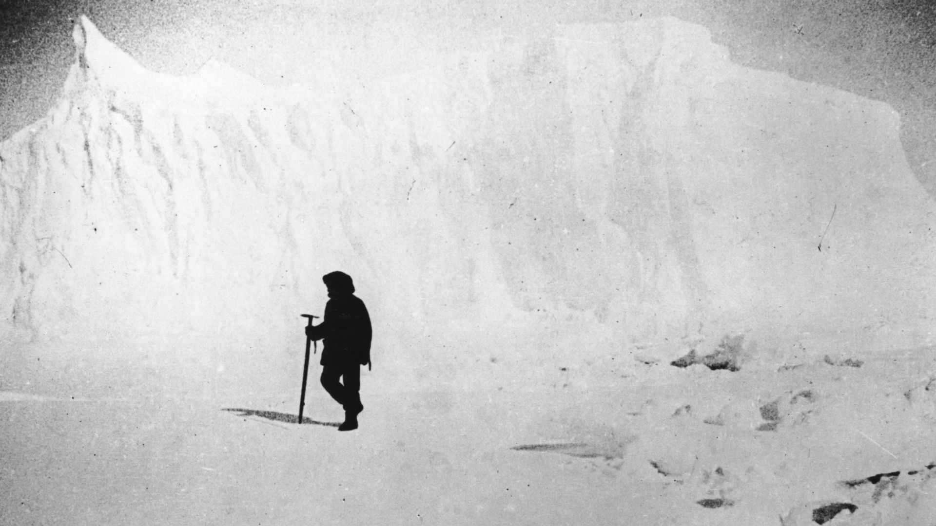 1911: Norwegian explorer Captain Roald Amundsen, the first man to reach the South Pole, inspecting ice fields near a glacier in the Atlantic Ocean.