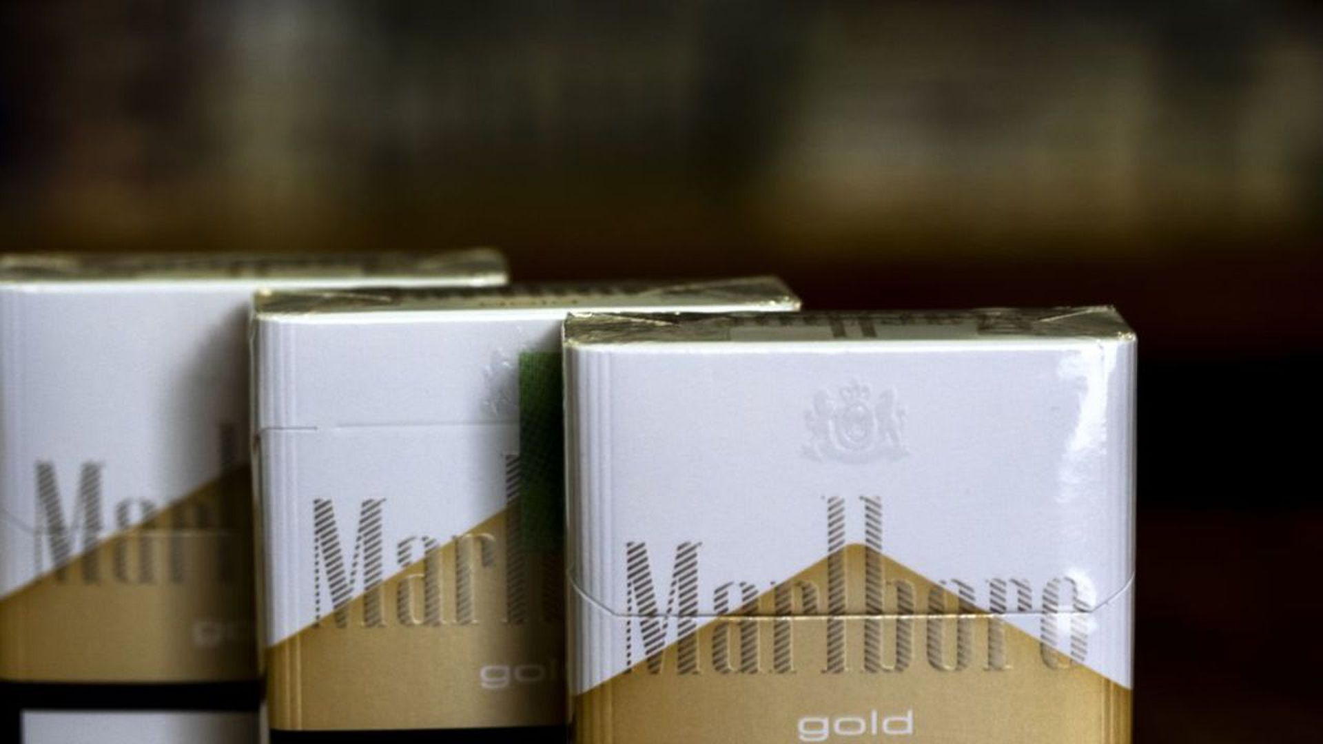 three packs of marlboro gold cigarettes
