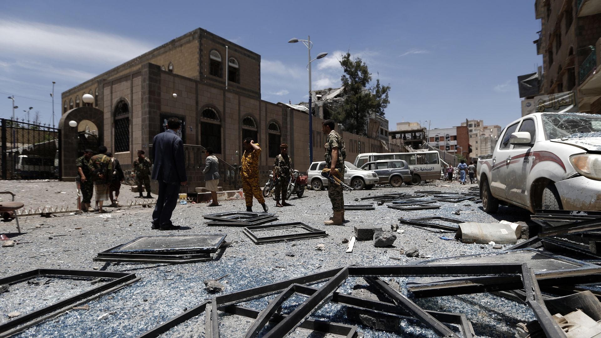 Yemenis check the site of air strikes at the president office in the capital Sanaa last month.