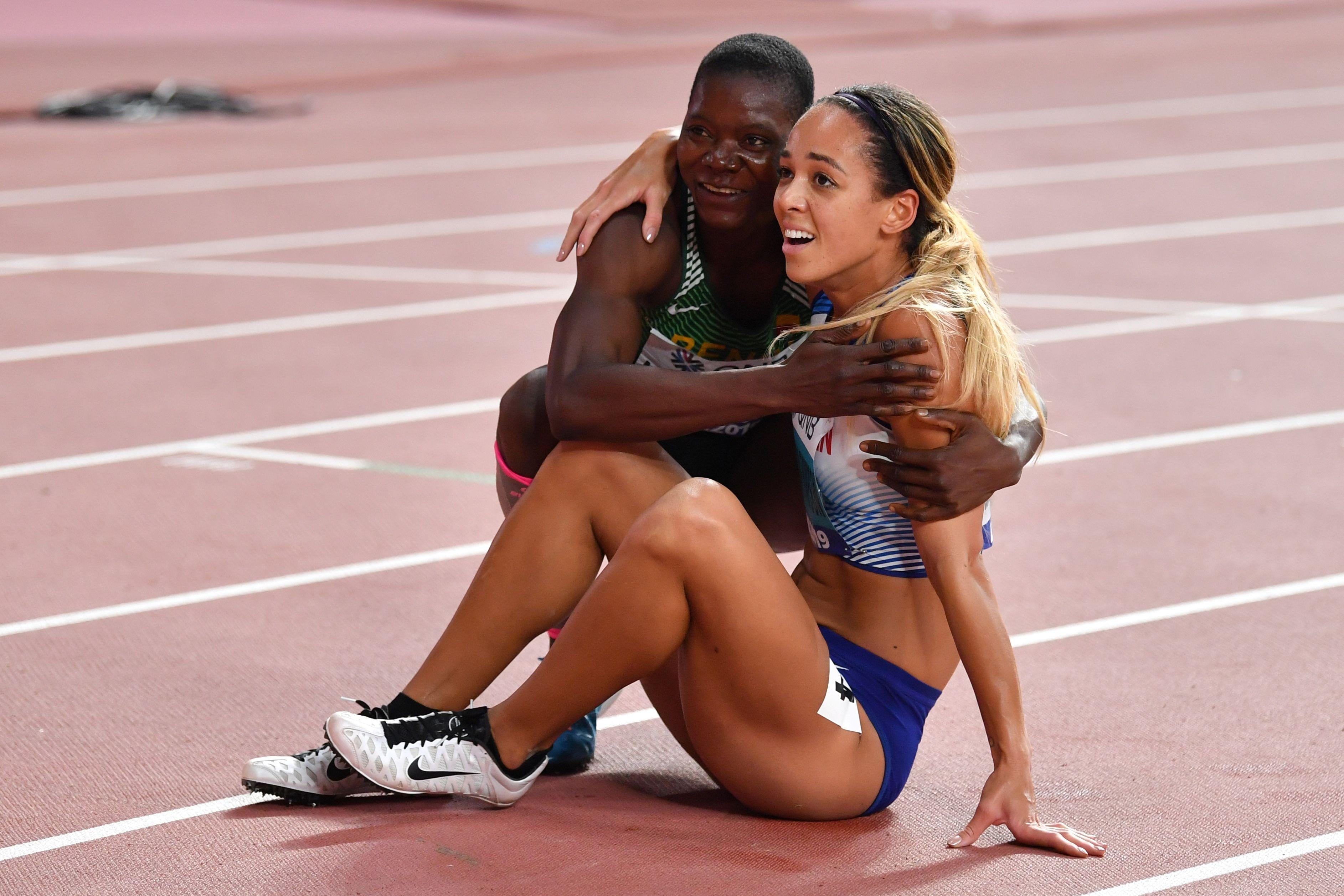 Track athletes hugging