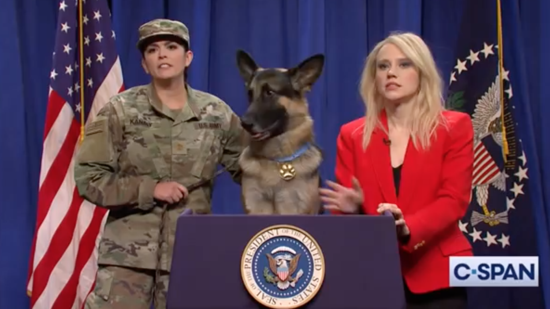 "A screenshot of the spoof press conference on NBC's ""Saturday Night Live"" featuring ""Conan the dog."""