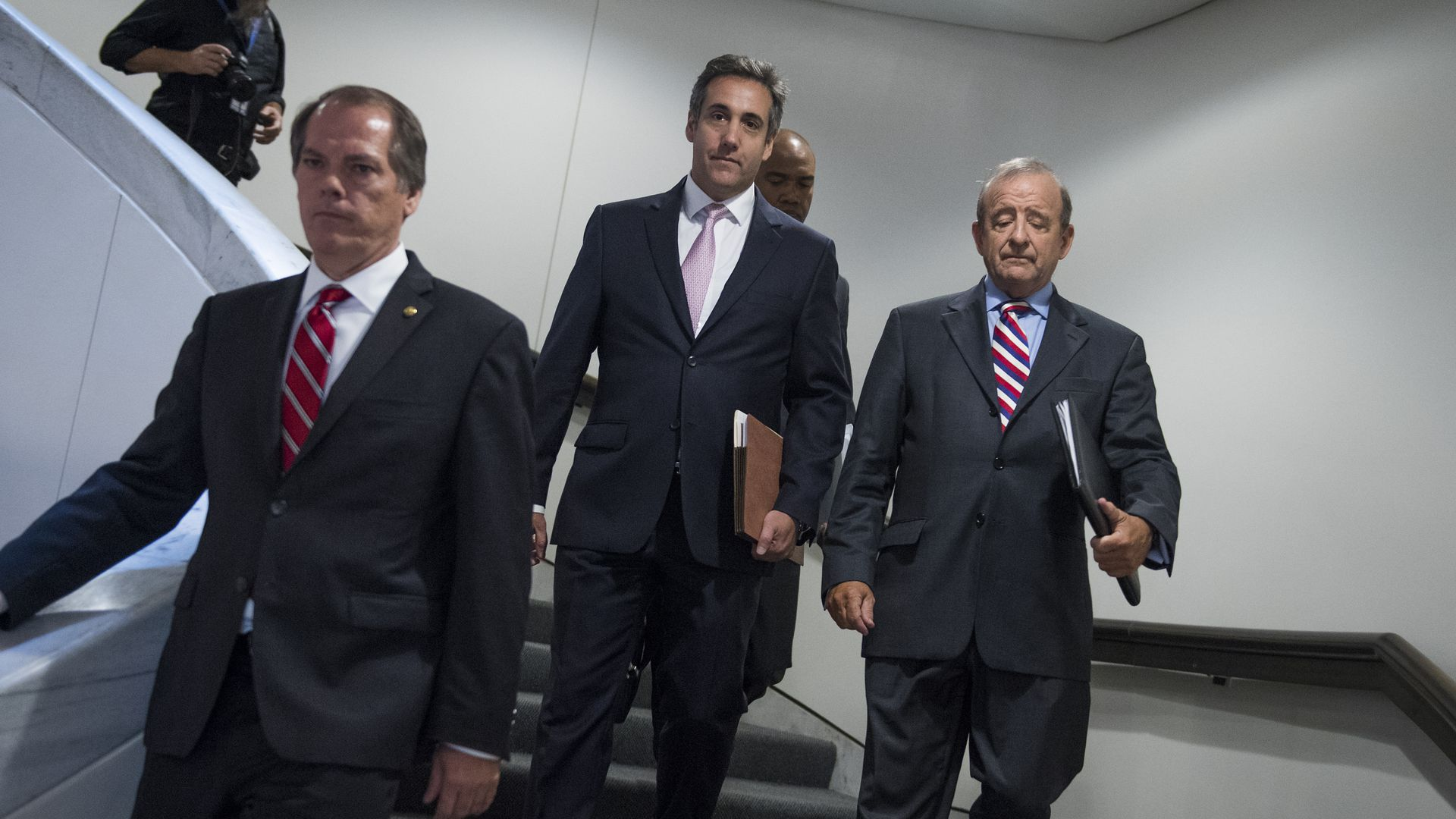 Michael Cohen, center, following his meeting with the Senate Intelligence Committee. Photo: By Tom Williams / CQ Roll Call