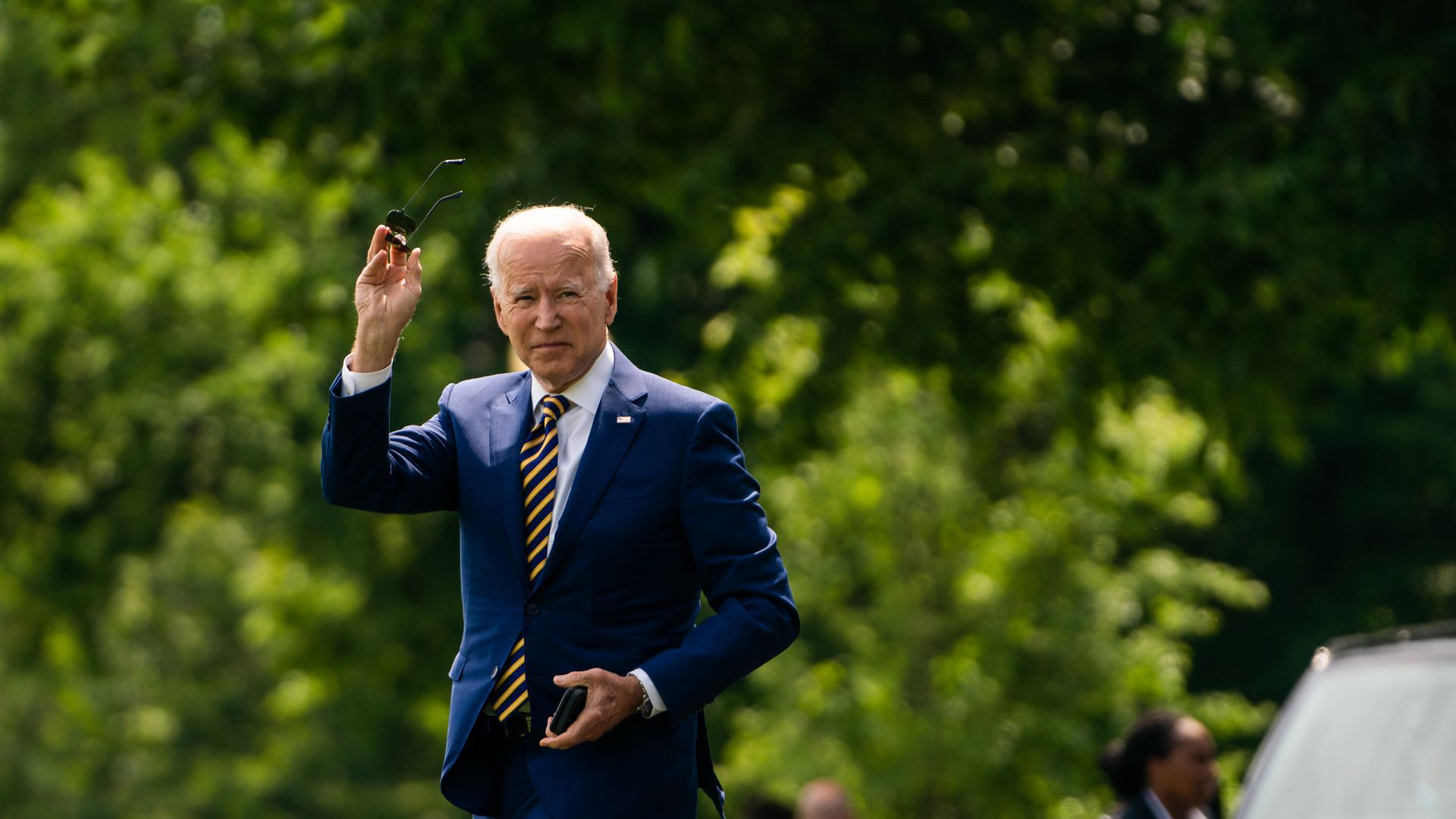 President Joe Biden waves as he gets ready to board Marine One.