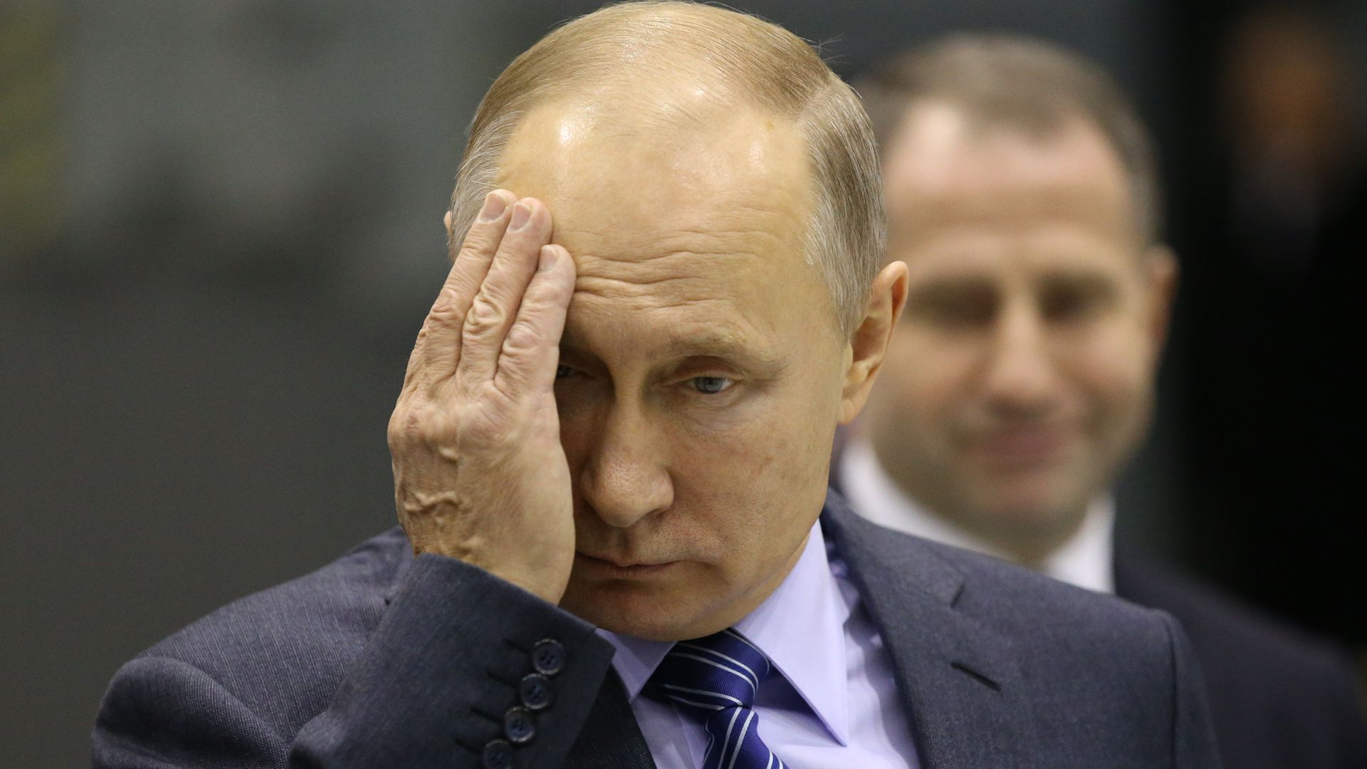 Vladimir Putin with his hand on his face