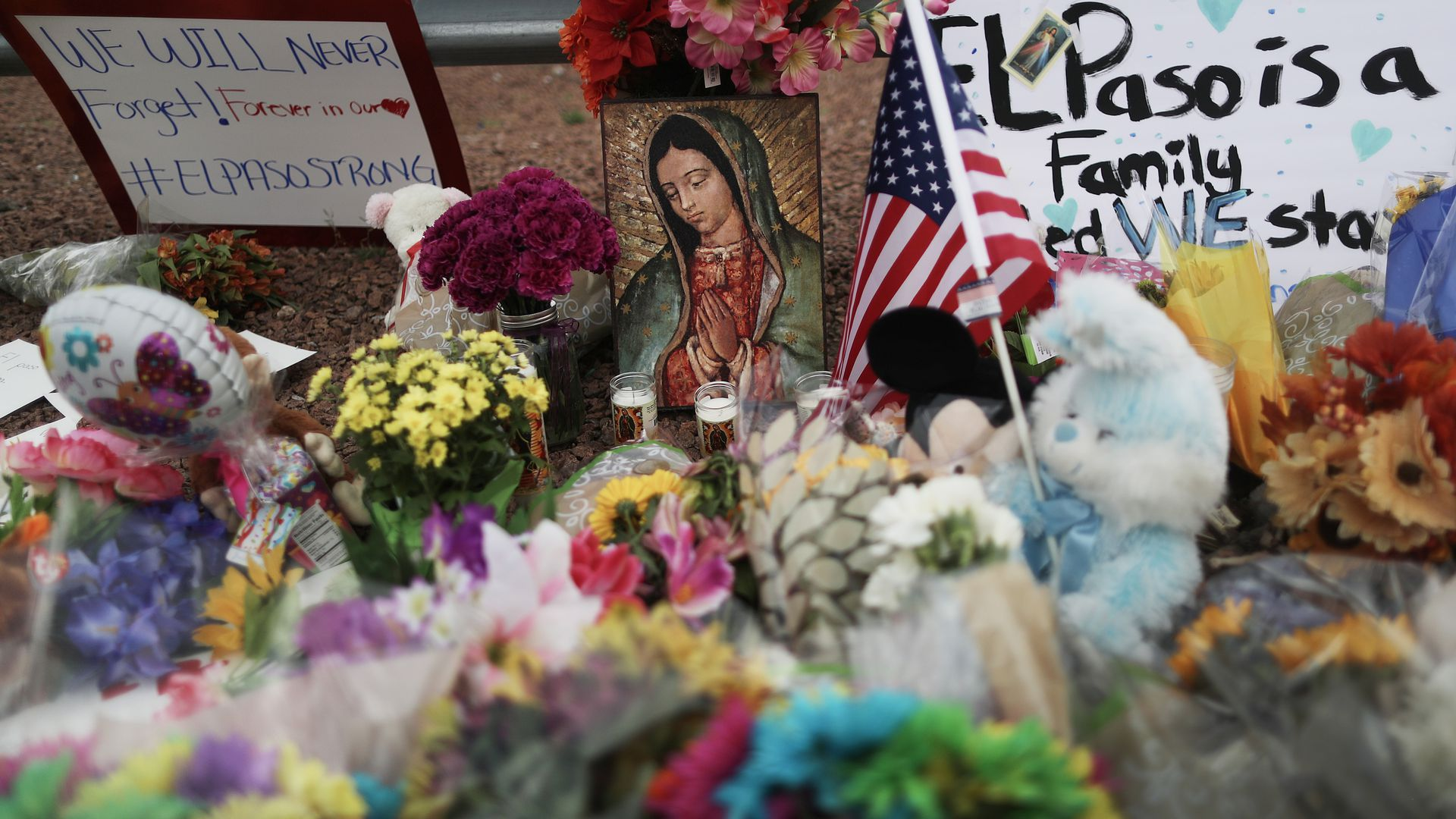 Flowers and mementos are seen at a makeshift memorial outside Walmart, near the scene of a mass shooting which left at least 20 people dead, on August 4, 2019 in El Paso