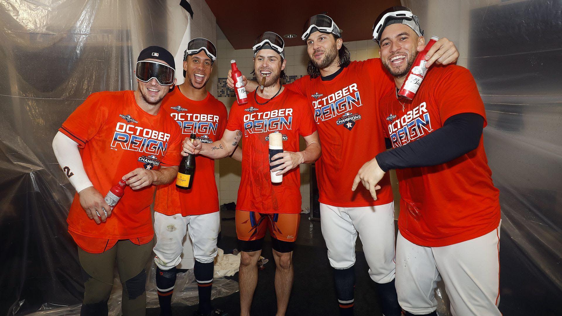 Baseball players popping bottles