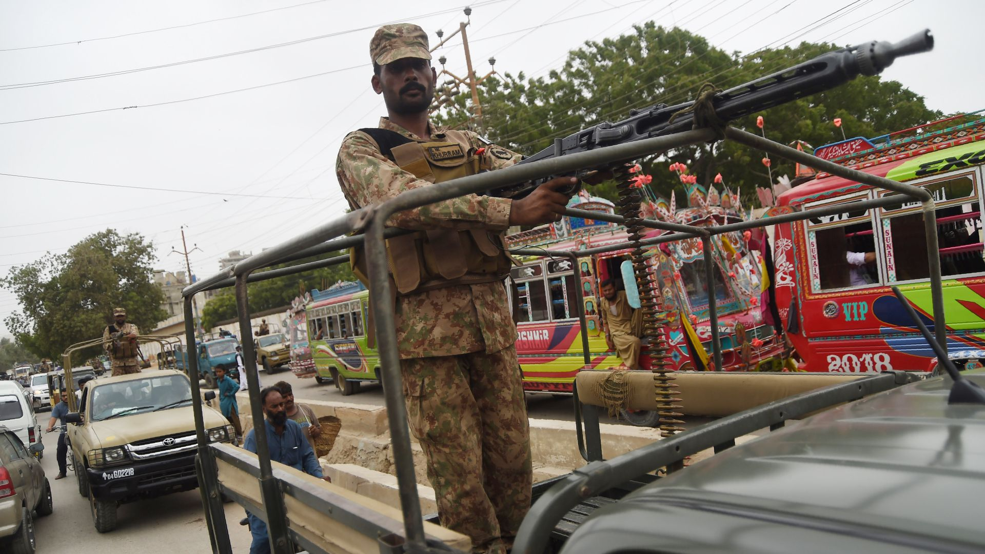 Pakistani soldiers patrol a street in an armored truck in the port city of Karachi on July 24, 2018.
